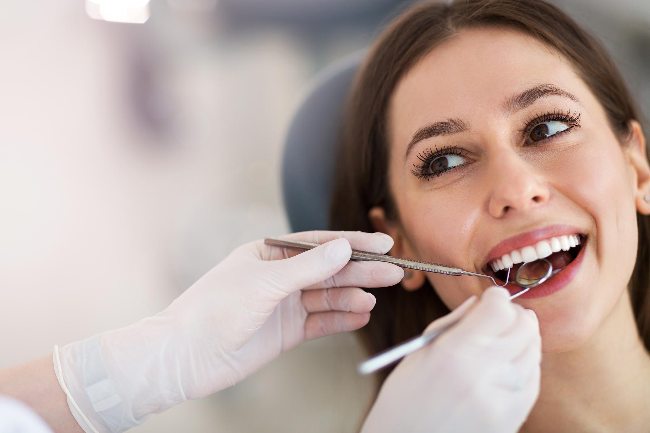 A woman receiving dental exam.