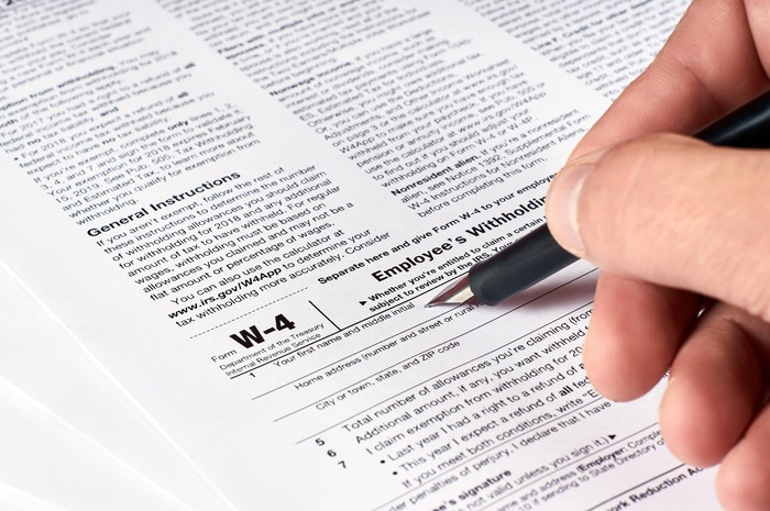 Person filling out Form W-4