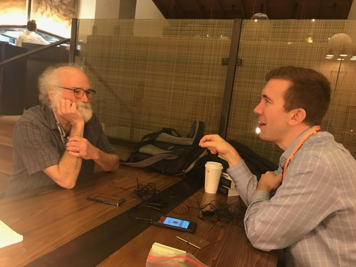 A photo of IBM fellow John Cohn speaking with Motley Fool Explorer advisor Simon Erickson