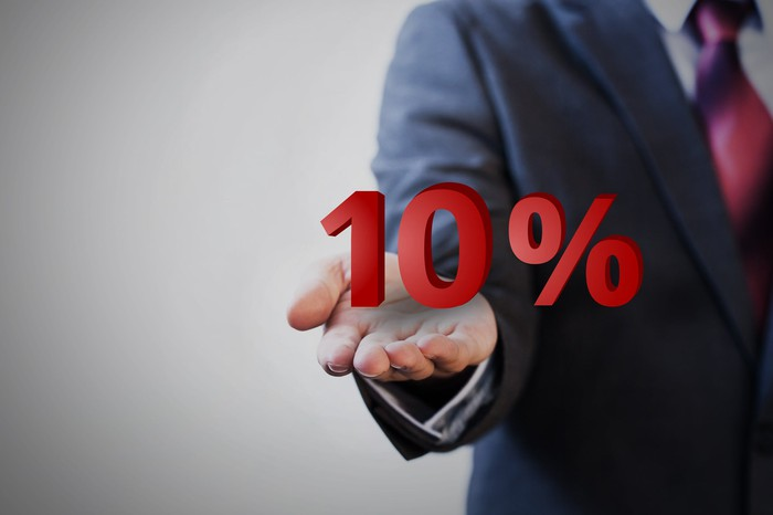 Man holding outstretched palm with the figure 10% in red floating above it.
