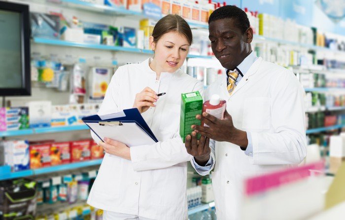 A male and a female pharmacist in a store