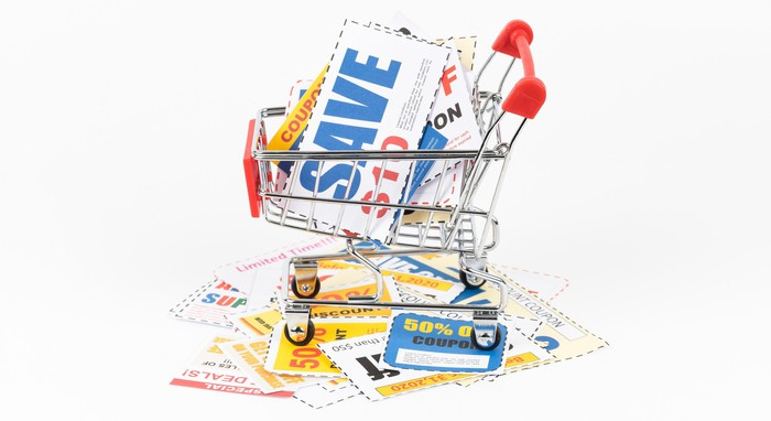 A grocery cart filled with coupons and vouchers.