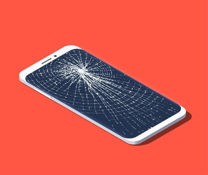 A smartphone with a broken screen.