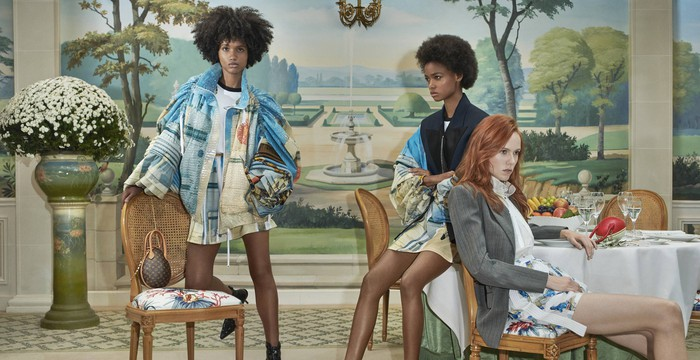 Three women in a Louis Vuitton ad campaign.