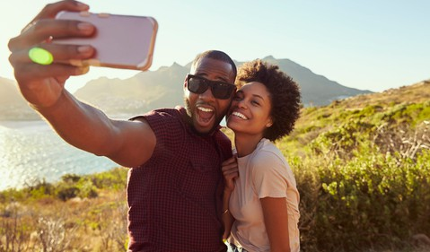 black couple selfie snap getty