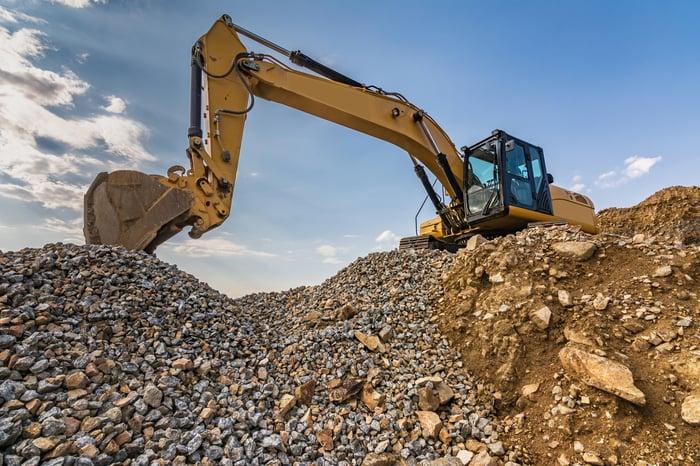 Excavator digging gravel