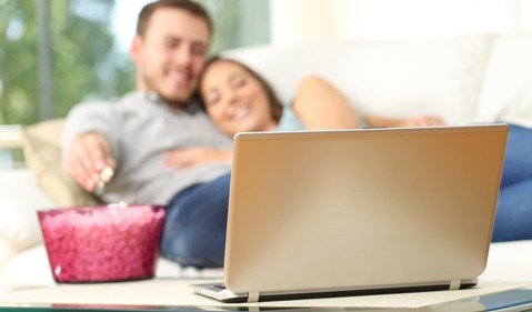 AG couple watching TV on couch