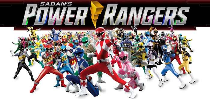 Dozens of Power Rangers assume fighting stances.