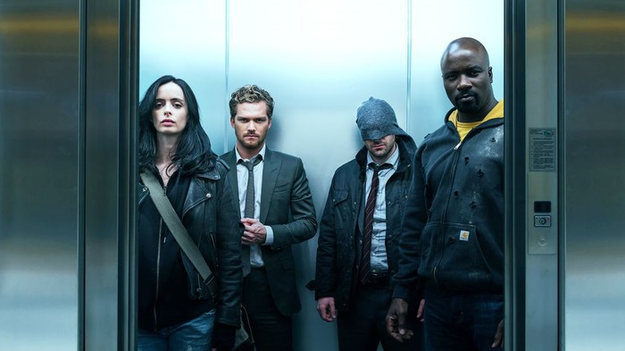 Stars of The Defenders boarding an elevator.