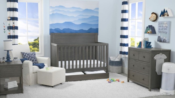 A baby's room in blue and grey