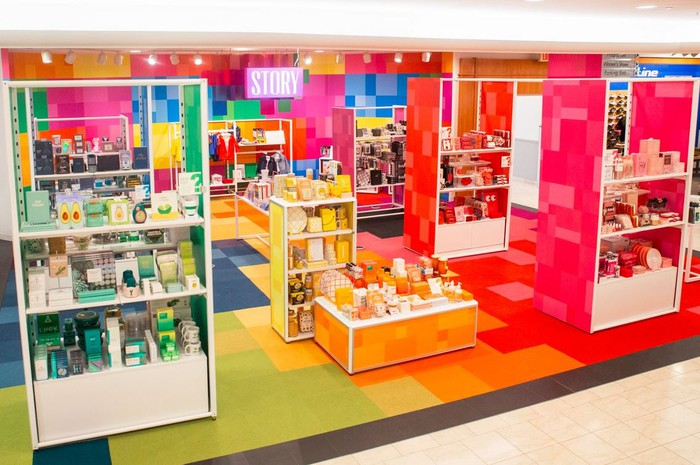 A STORY boutique in a Macy's store, featuring the color theme