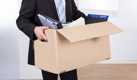laid off man with boxed up belongings_GettyImages-516249391