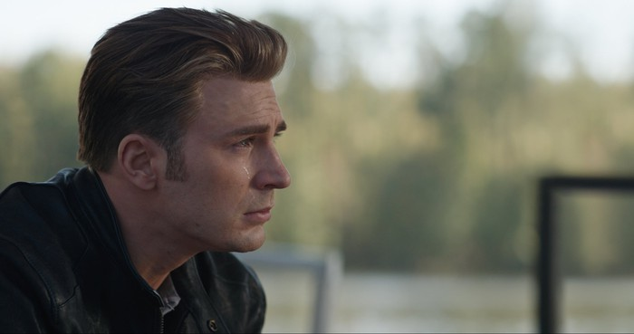 Chris Evans as Captain America with a tear rolling down his cheek in a scene from Avengers: Endgame.
