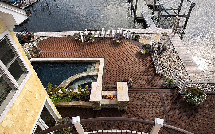 Trex composite decking displayed as part of a large deck with swimming pool and dock