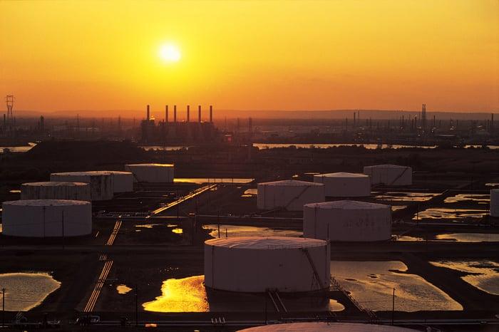 Oil storage tanks at sunset.