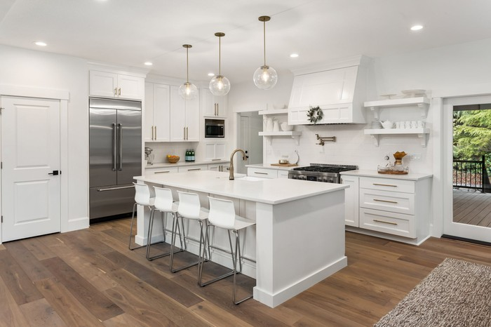 Large white kitchen with center island