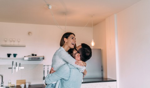young couple in kitchen_GettyImages-964372222