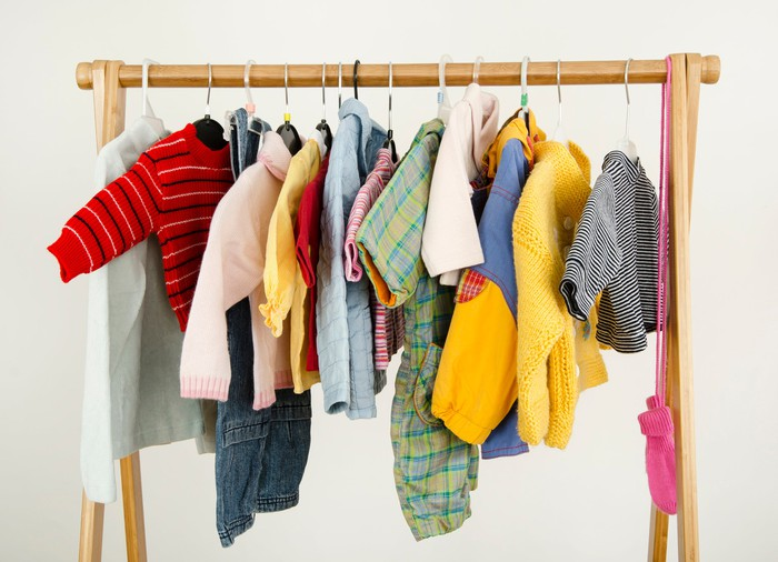 A rack of children's apparel.