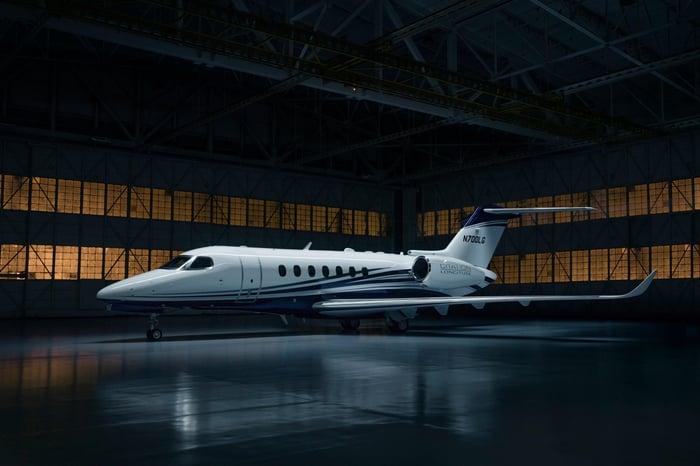 A Cessna business jet in a hangar.