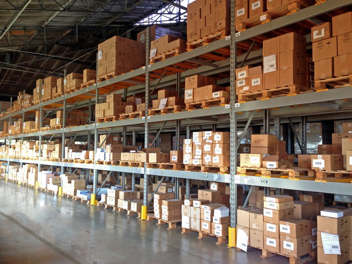 Rows of industrial shelving full of boxes in a warehouse
