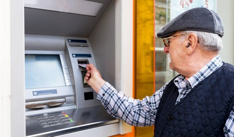 senior man at ATM_GettyImages-611077470