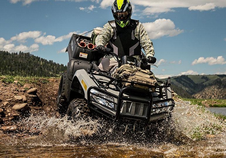 Man riding ATV into a river