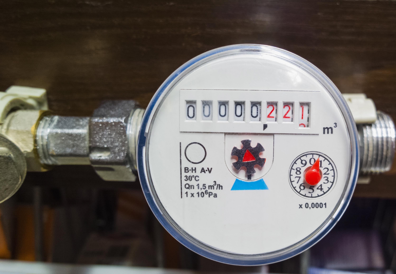 Close-up of a water meter displaying water usage volume.