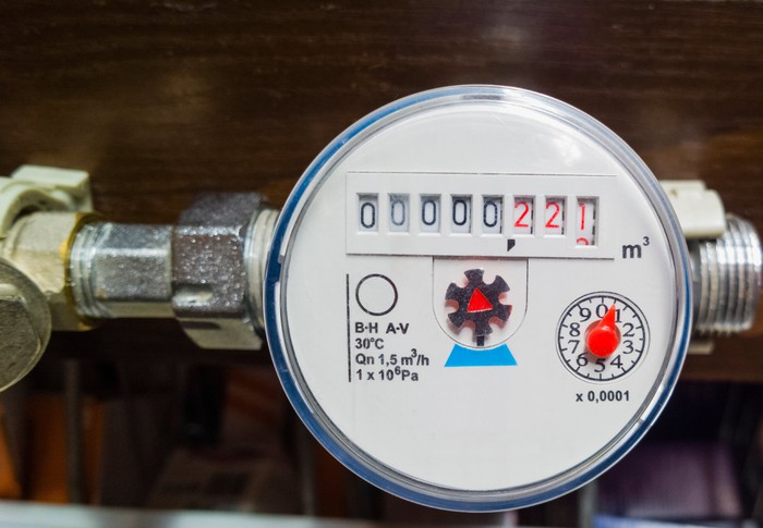 Close-up of a water meter displaying water usage volume.