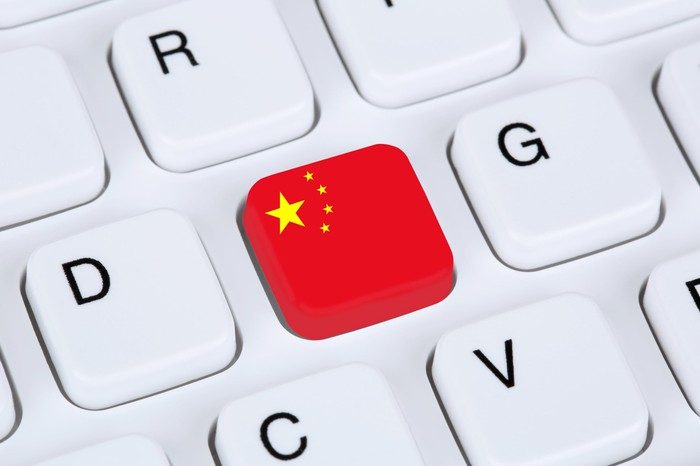 "A Chinese flag replacing the ""F"" key on a computer keyboard."
