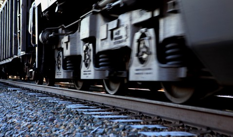 Close-Up of Freight Train Moving Along Tracks