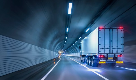 Commercial Truck Passing Through Tunnel