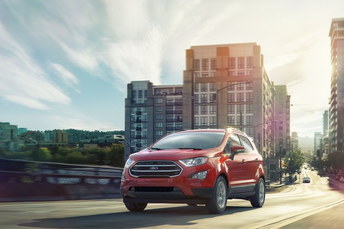A red Ford EcoSport on a city street