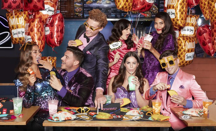 An after-prom party at Taco Bell with seven well-dressed attendees.