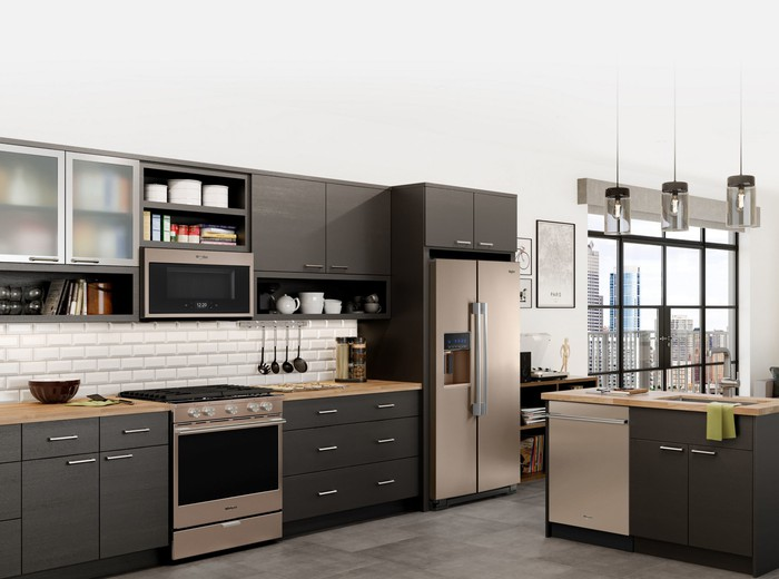 A neatly kept modern kitchen next to floor-to-ceiling windows.
