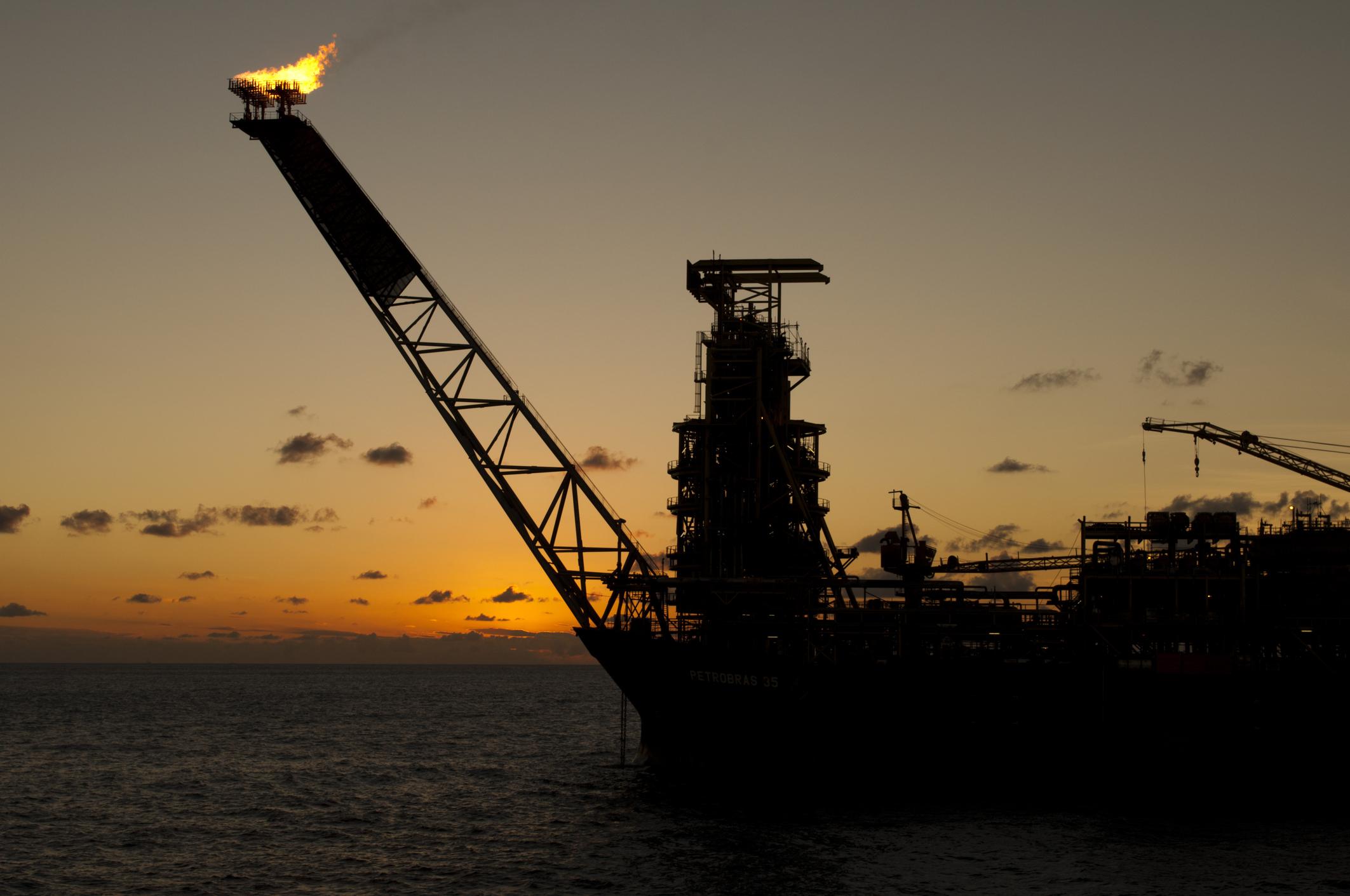 Offshore oil rig at sundown.