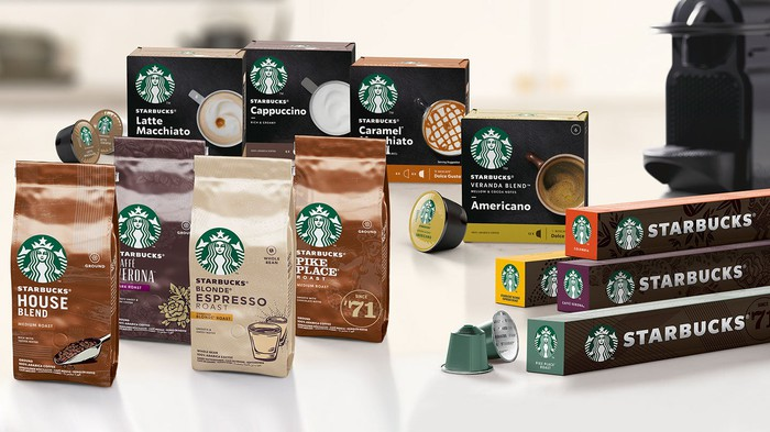 Several bags and boxes of Starbucks coffee.