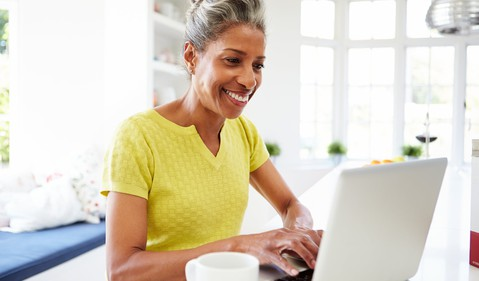 smiling older woman at laptop_GettyImages-462372963