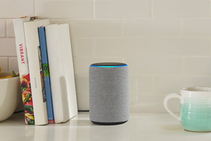 An Amazon Echo smart speaker on a countertop.