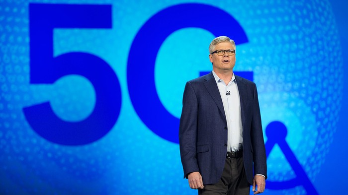 "Steve Mollenkopf speaking on stage in front of ""5G"""