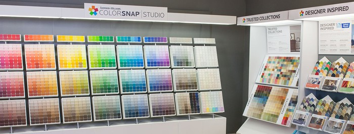 Display of paint color cards and promotional materials.
