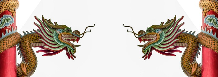Two Chinese dragons facing each other