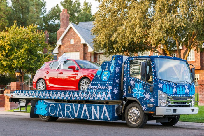Car being delivered via Carvana flatbed truck