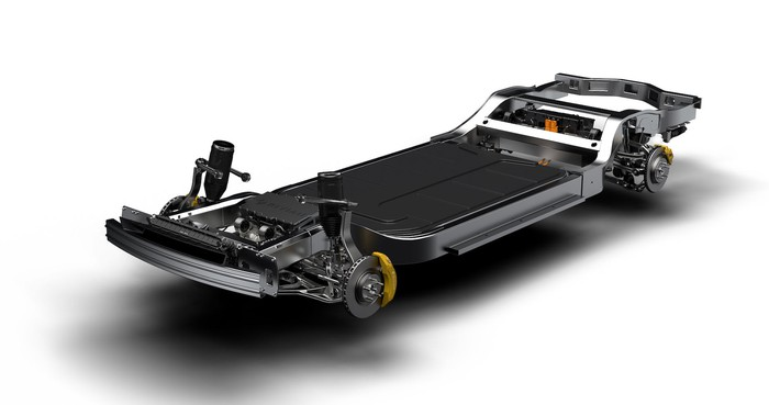 """The Rivian """"skateboard"""" vehicle platform, a chassis unit that includes electric motors, batteries, vehicle suspension components, and brakes"""