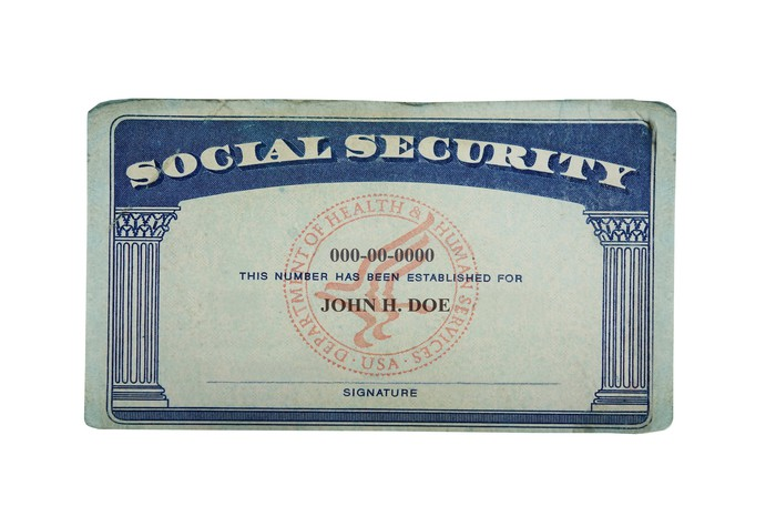 Social Security card on white background.