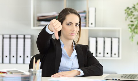 woman with thumbs down_GettyImages-957422342