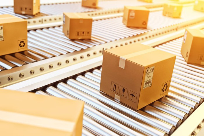 Cardboard boxes being sorted in a facility.