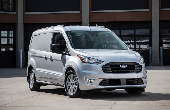 A silver 2019 Ford Transit Connect, a small commercial van.