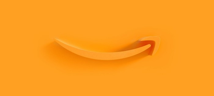 Amazon's smile logo rendered in 3D on orange background.