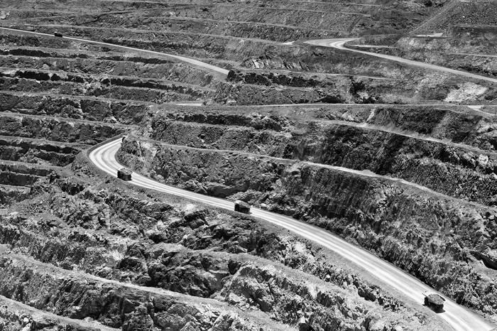 Trucks on an access road of a mine