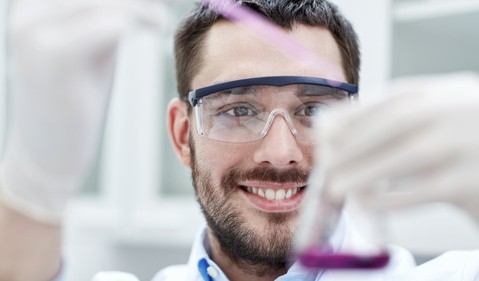 guy-in-a-labcoat-pipeting-purple-stuff-into-flask-getty